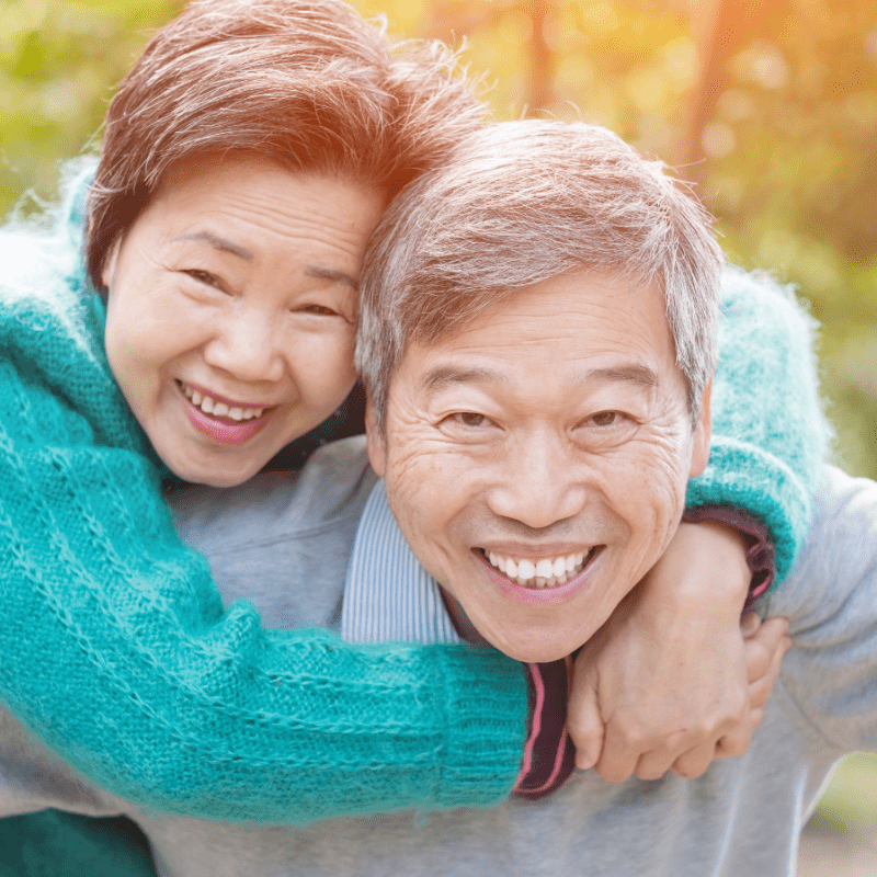 Old Asian couple smiling
